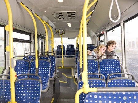asleep chair: Young couple sleeps on the bus