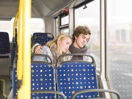 Young couple sleeps on the bus photo