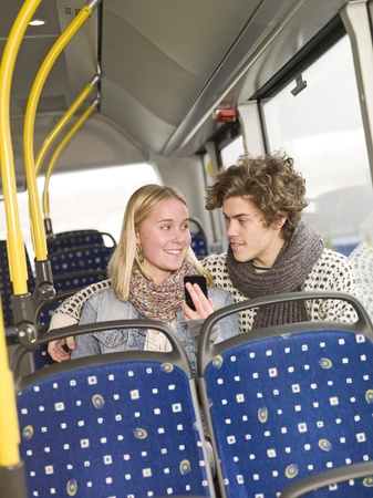 Young couple alone on the bus photo