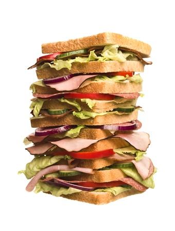oversized: Oversized sandwich isolated on white background Stock Photo