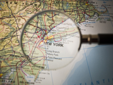 east coast: Magnifying Glass in front of a New York map Stock Photo