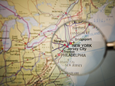Magnifying Glass in front of a New York map Stock Photo