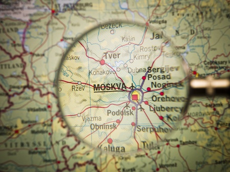 russia: Magnifying Glass in front of a Moscow map