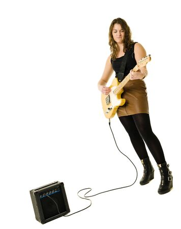 Young woman playing electric guitar isolated on white background photo