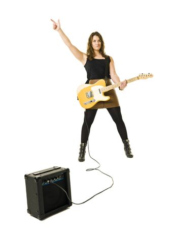 guitar amplifier: Young woman playing electric guitar isolated on white background Stock Photo