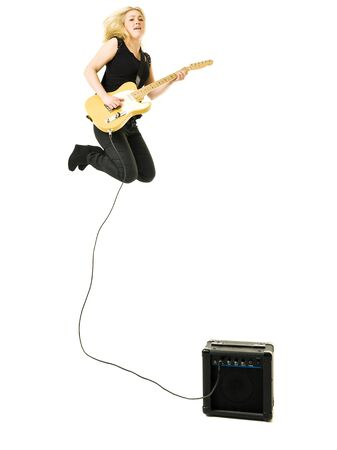 Young woman playing electric guitar isolated on white background Stock Photo - 11741040