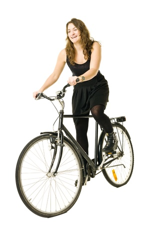 Woman on a bicycle isolated on white background Stock Photo - 11741403