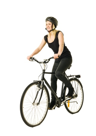 Woman on a bicycle isolated on white background photo
