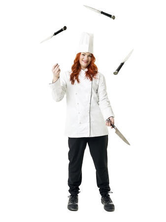 woman knife: Juggling readhaired Chef isolated on white background Stock Photo