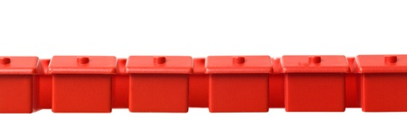 Row of Toy house on white background photo