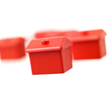 Red Toyhouse isolated on white background photo