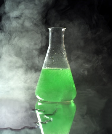 Laboratory Glass with green liquid Stock Photo