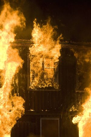 house on fire: Apartment building on Fire at Night time