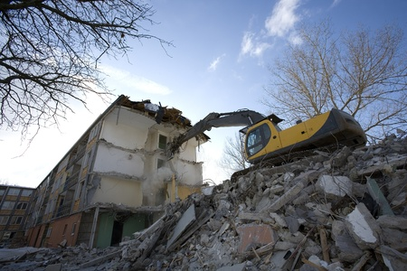 tearing down: Tearing down an apartment block Editorial