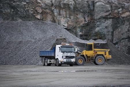 mining equipment: Trucks at a pit mine