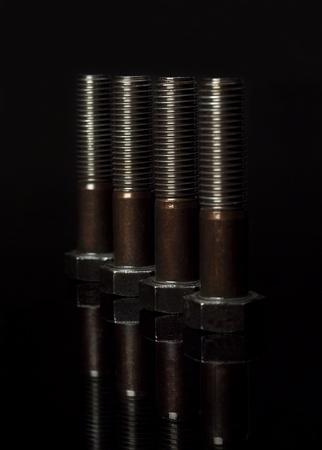 Group of screws on black background photo