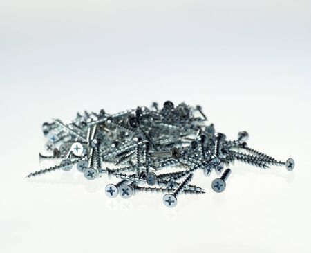 fasteners: Stack of screws isolated on white background Stock Photo