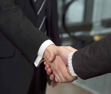 Close-up of a handshake with selective focus photo
