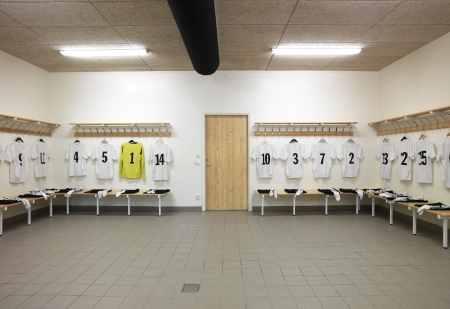 sports league: Soccer teams dressing room with numbered shirts Editorial
