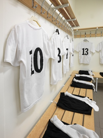 Soccer teams dressing room with numbered shirts Editorial