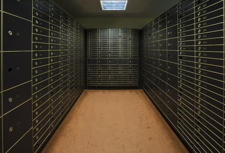safe deposit box: Room with a large group of safety boxes