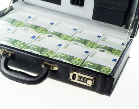 Briefcase with money isolated on white background photo