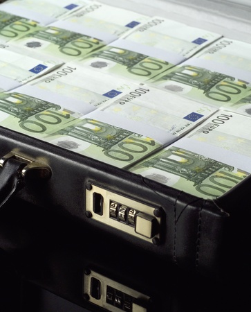 Briefcase with money isolated on black background photo