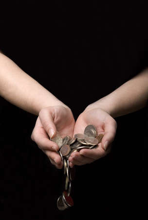 Coins flowing out of hands photo