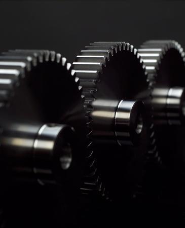 machine teeth: Industry wheels on black background Stock Photo