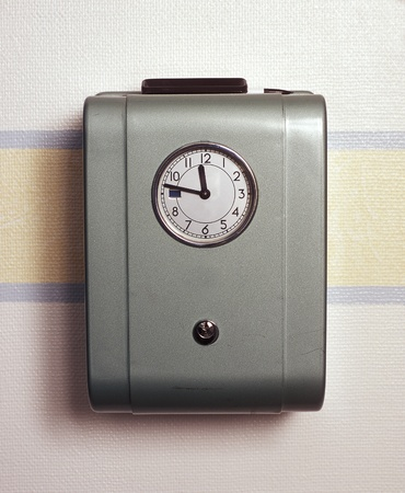 checking the time: Retro Time Clock on the wall Stock Photo