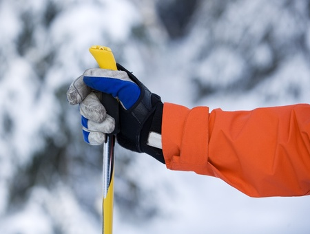ski resort: Hand and ski pole with selective focus