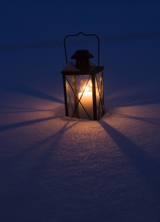 Lantern in the dark snow photo