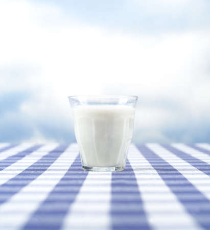 dairy product: Glass of Milk towards blue sky