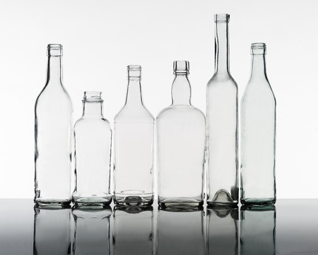 glass jar: Group of bottles isolated on white background