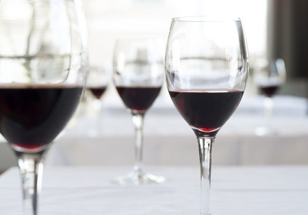 filming point of view: Glasses with red wine on a table