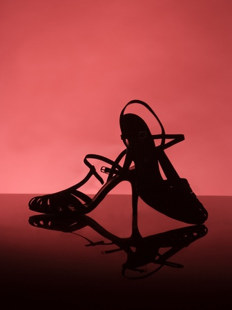 Female shoes on red background photo