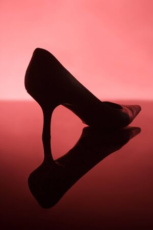 Female shoe on red background photo