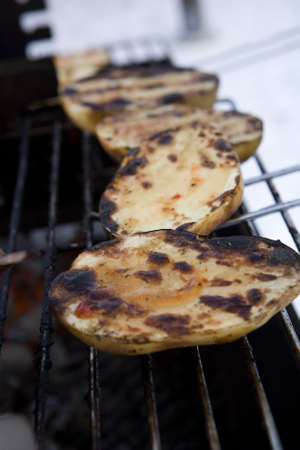 campfires: Close up of a Barbeque with potatoes