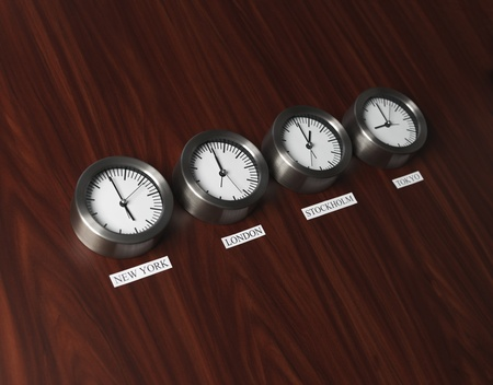 Four clocks with different time on Teak background Stock Photo - 12601334