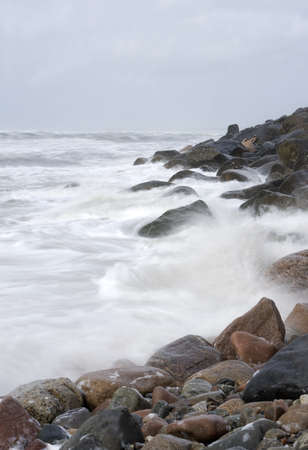 Rocky Coastline with moving waves photo