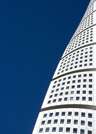 blu: White Skyscraper towards blue sky