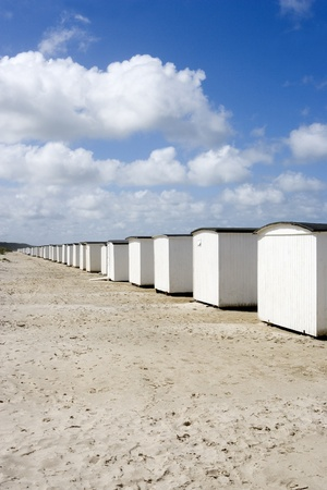 neighbours: Row of White boathouses on the beach Stock Photo