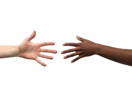 racisme: Twee handen die elkaar