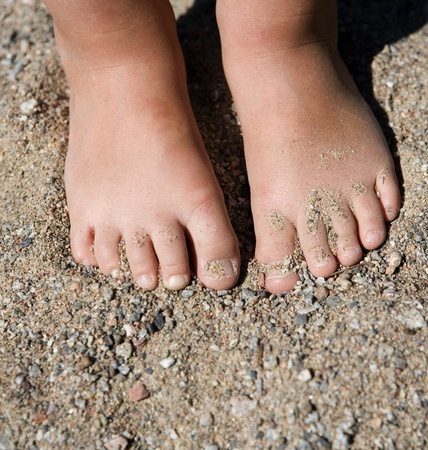 baby's feet: Babys feet in the sand Stock Photo
