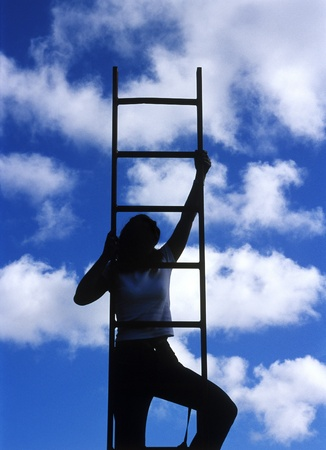 achievment: Silhouette of a woman climbing the ladder Editorial