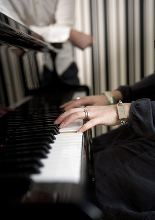 Unreconizable woman playing the piano Stock Photo - 12601035