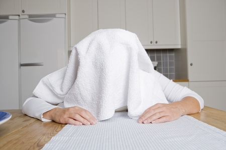 Cold woman with a towel at home Stock Photo - 12601023