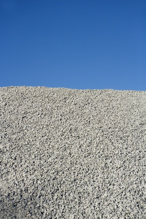 construction material: Stack of Gravel towards Blue sky