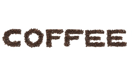 The word coffe written with coffee beans photo