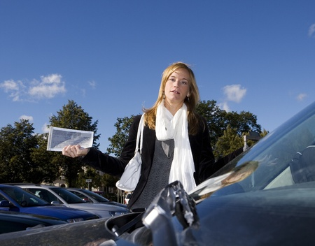 offense: Angry woman getting a Parking Ticket